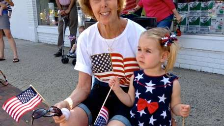 With flags in hand, 2-year-old Diana Sobel and