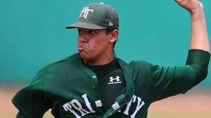 Holy Trinity starting pitcher Alex Robinson delivers to