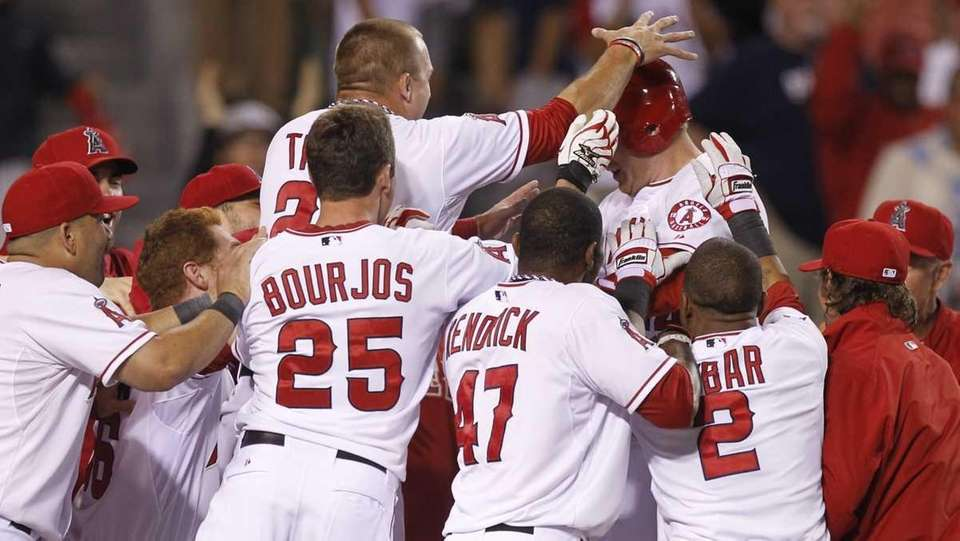 Los Angeles Angels' Mark Trumbo, top right, celebrates