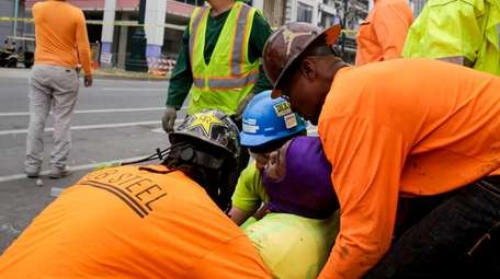 Workers are helped after a large portion of