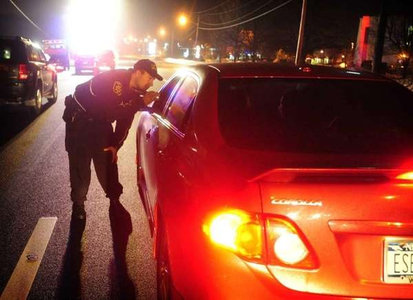 Suffolk County Deputy Sheriff Robert Howard checks cars