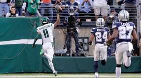 The Jets' Robby Anderson reacts as he scores