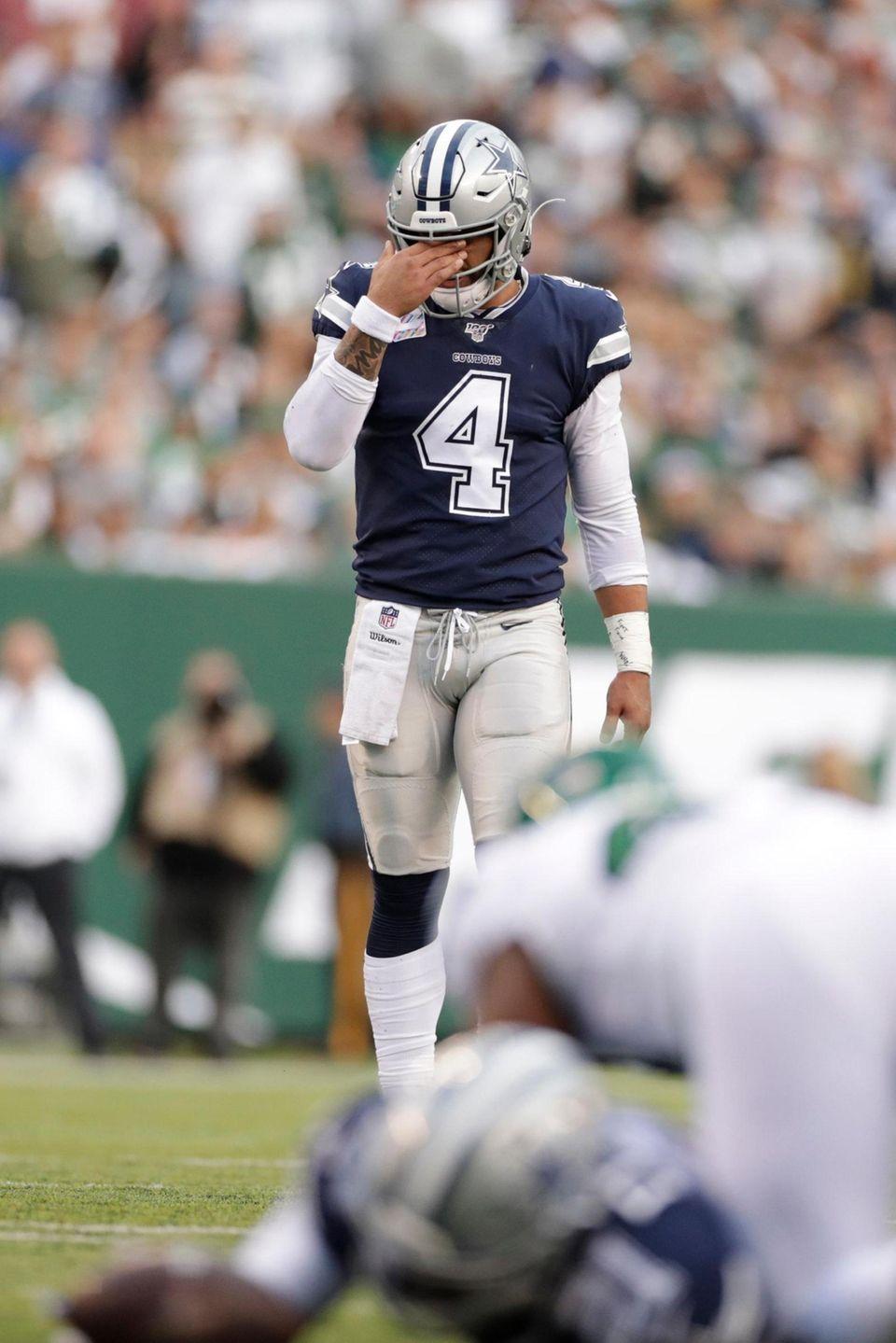 Dallas Cowboys' Dak Prescott reacts during the first