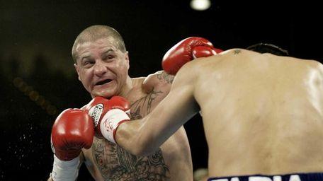 Johnny Tapia, left, defends against Marco Antonio Barrera