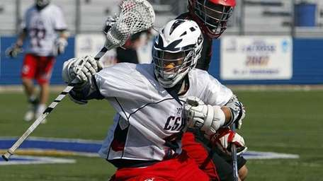 Cold Spring Harbor's Sean Doyle spins away from