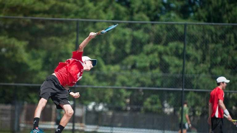Half Hollow Hills East's Kyle Alper hits the
