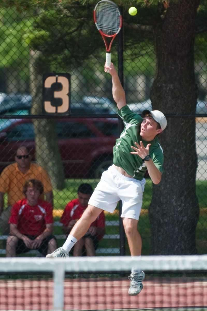 Ward Melville's Jacob Rothstein serves the ball during