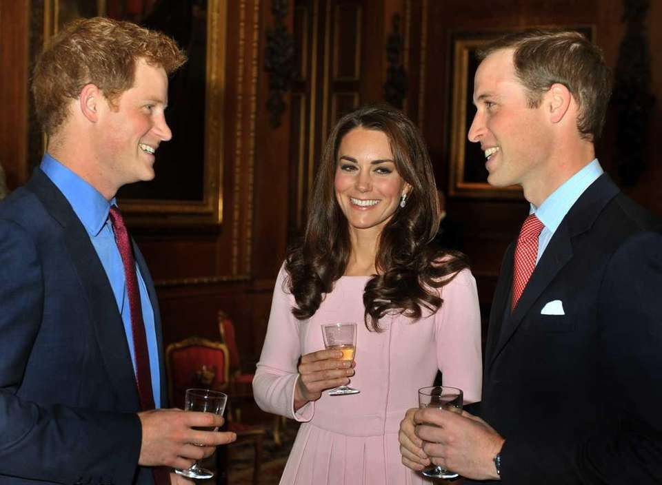 Prince William, right, talks with his wife Catherine,