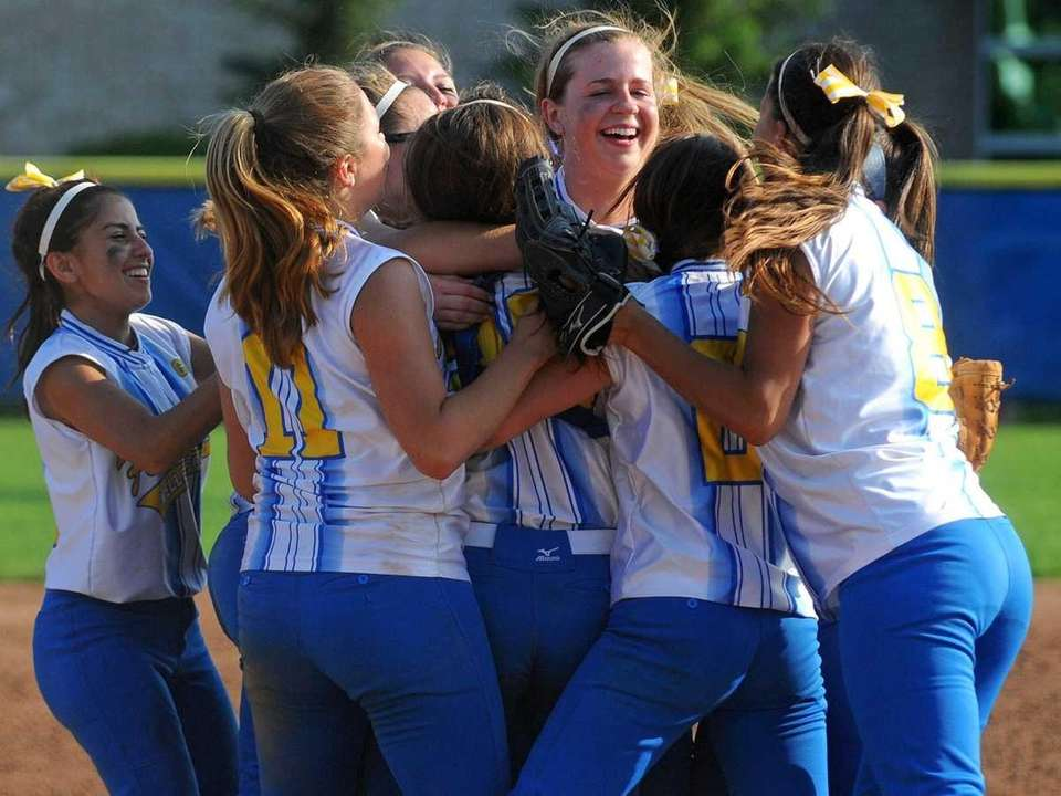 Kellenberg teammates celebrate after winning the NYCHSAA varsity