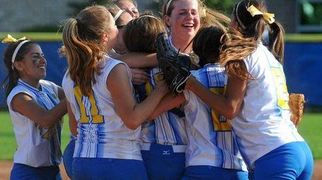 Kellenberg teammates celebrate after winning the NYCHSAA varsity