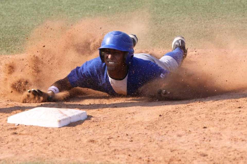 Calhoun's Alex Vargas slides into third base for