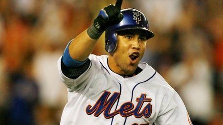 The Mets' Calros Beltran celebrates his walk off