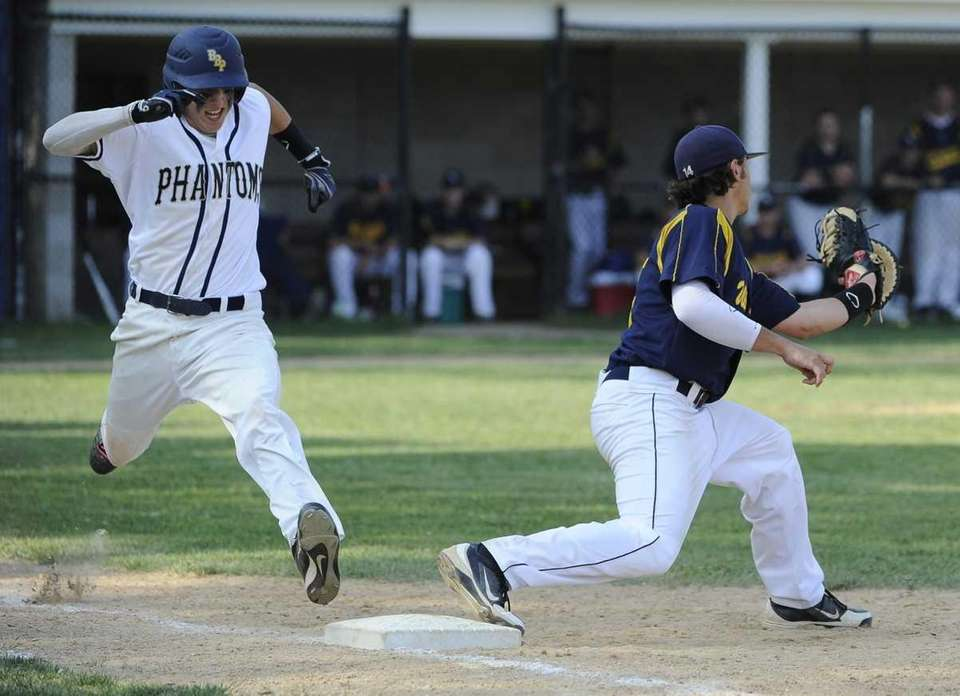Shoreham-Wading River's Nick Bottari makes the catch for
