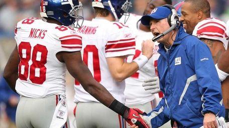 Head coach Tom Coughlin of the Giants congratulates