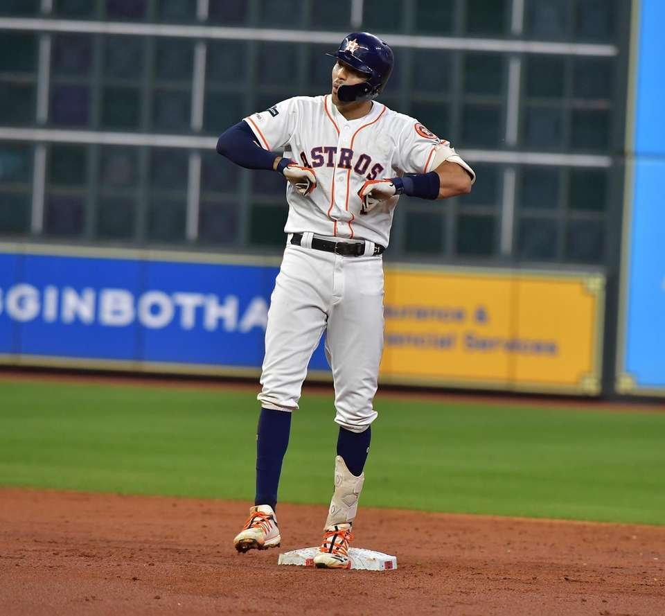 Houston Astros shortstop Carlos Correa (1) reacts in