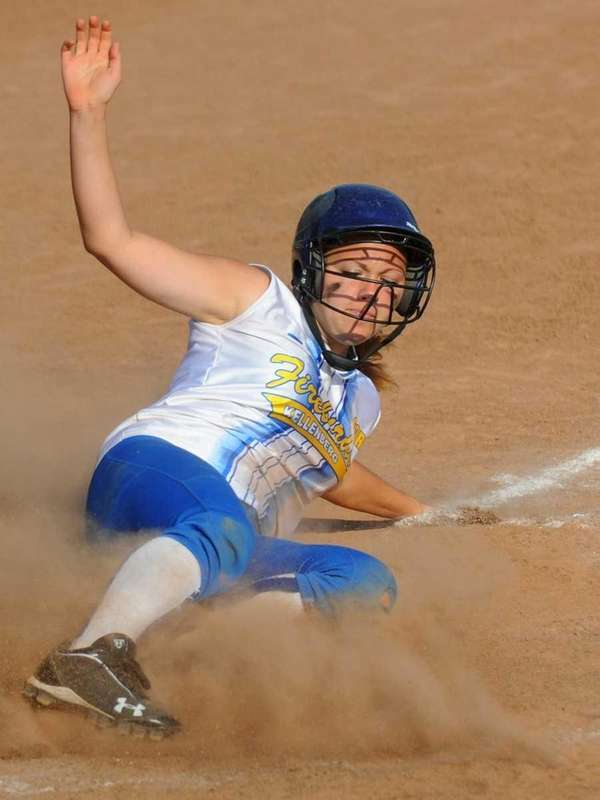 Kellenberg's Lindsey Wiese slides home safely to extend