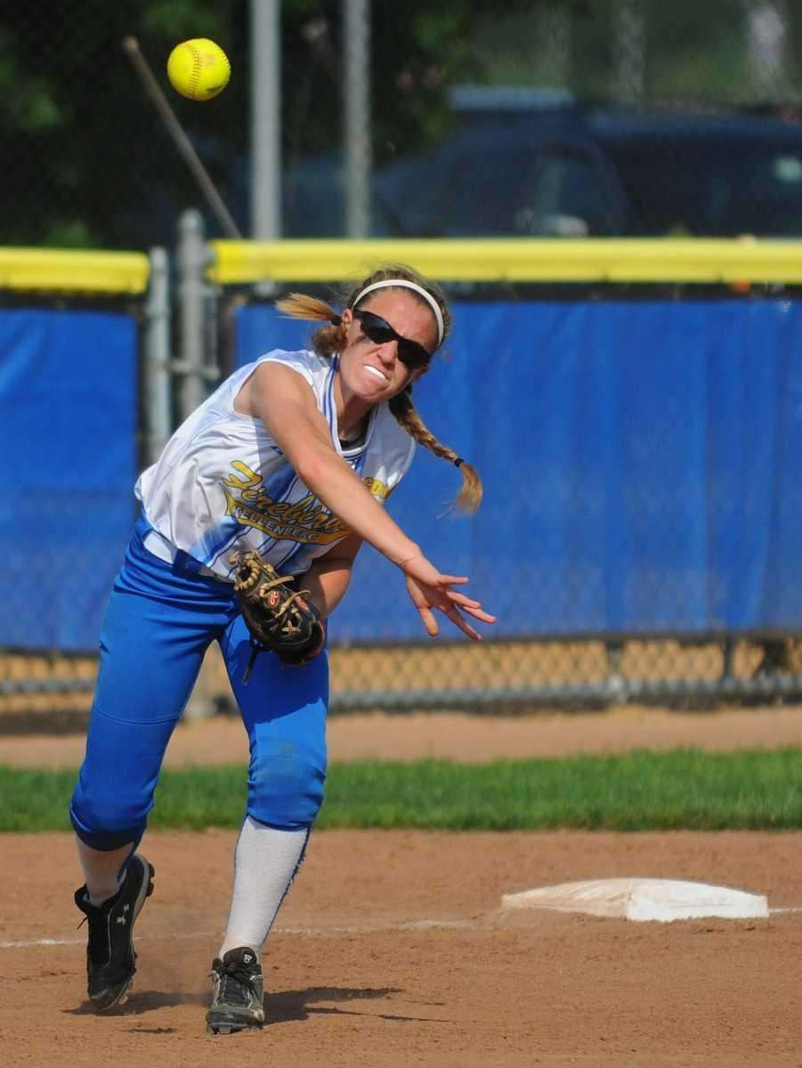 Kellenberg third baseman Stephanie Staiano throws to first
