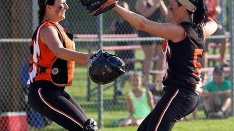 Babylon pitcher Tiana Guiliano #5 and catcher Michelle