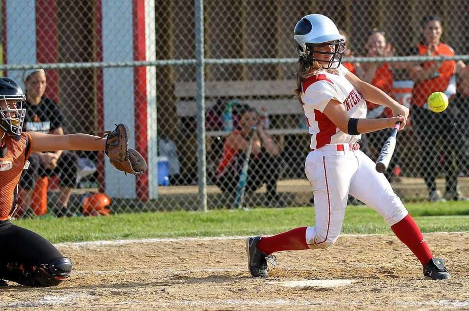 Center Moriches' Megan Ricci #12 drives a hit