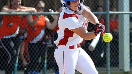 Center Moriches' Tori Fahie tries for a hit
