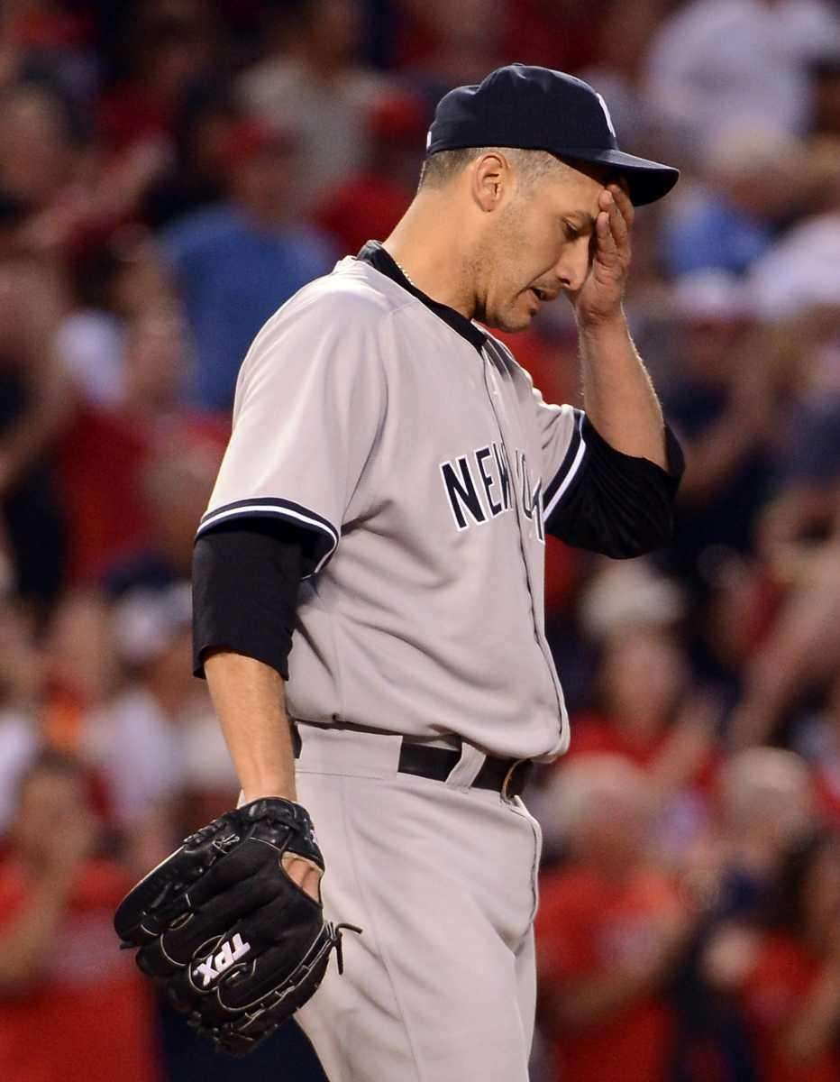 Andy Pettitte #46 of the Yankees reacts after