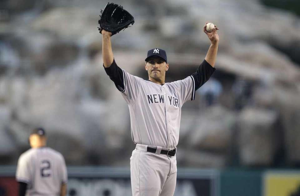 Yankees starting pitcher Andy Pettitte gestures during the