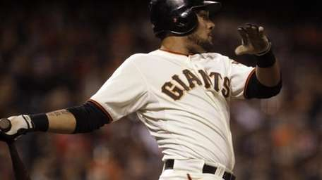 San Francisco Giants' Melky Cabrera swings for a