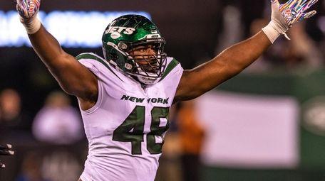 Jets outside linebacker Jordan Jenkins celebrates a sack