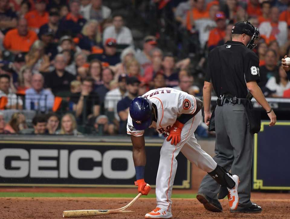 Houston Astros left fielder Yordan Alvarez (44) brakes