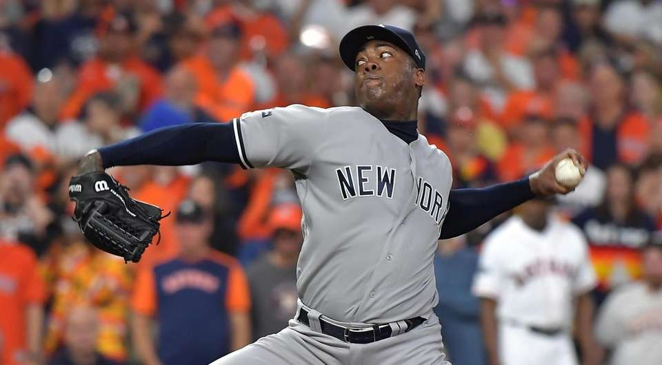 Yankees relief pitcher Aroldis Chapman delivers in the