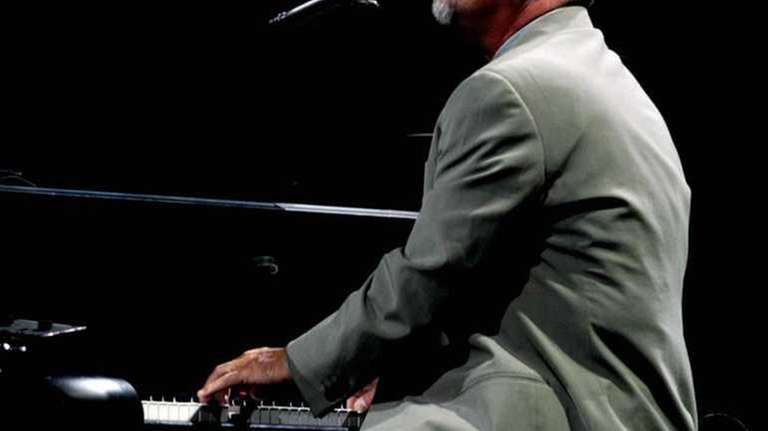 A seemingly melancholic Billy Joel performs early in
