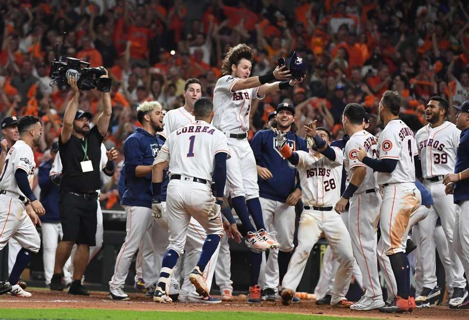 Houston Astros shortstop Carlos Correa (1) is mobbed