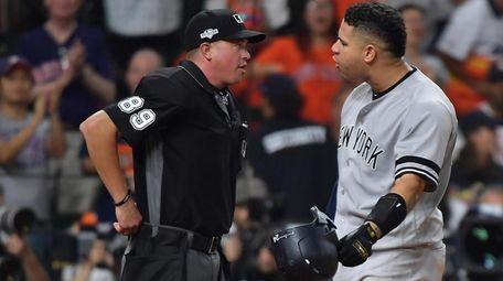 Yankees catcher Gary Sanchez (24) argues the strike