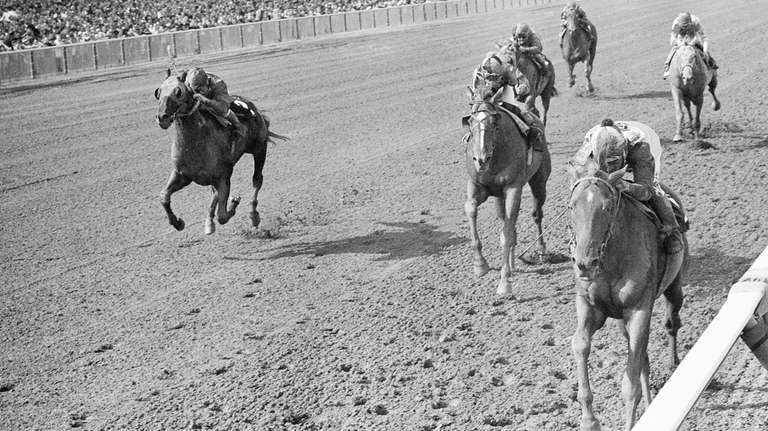 Chateaugay, right, with jockey Braulio Baeza, charges to
