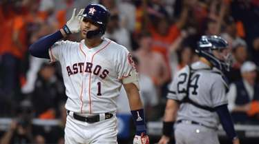 Astros shortstop Carlos Correa reacts after his walk-off