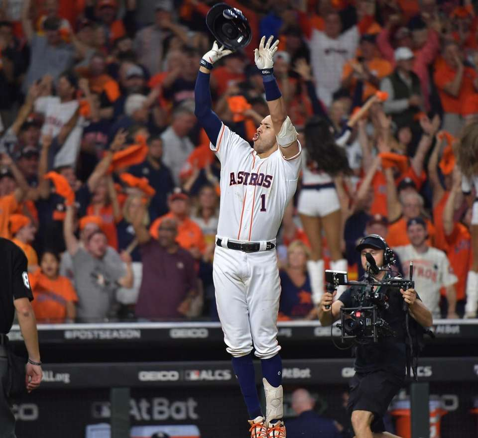 Houston Astros shortstop Carlos Correa (1) reacts after