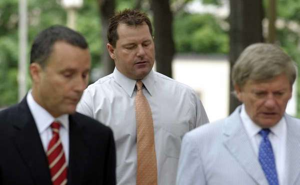 Former Major League baseball pitcher Roger Clemens, center,