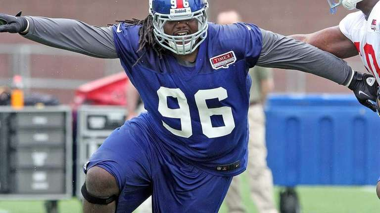 Giants defensive tackle Marvin Austin practices rushing the