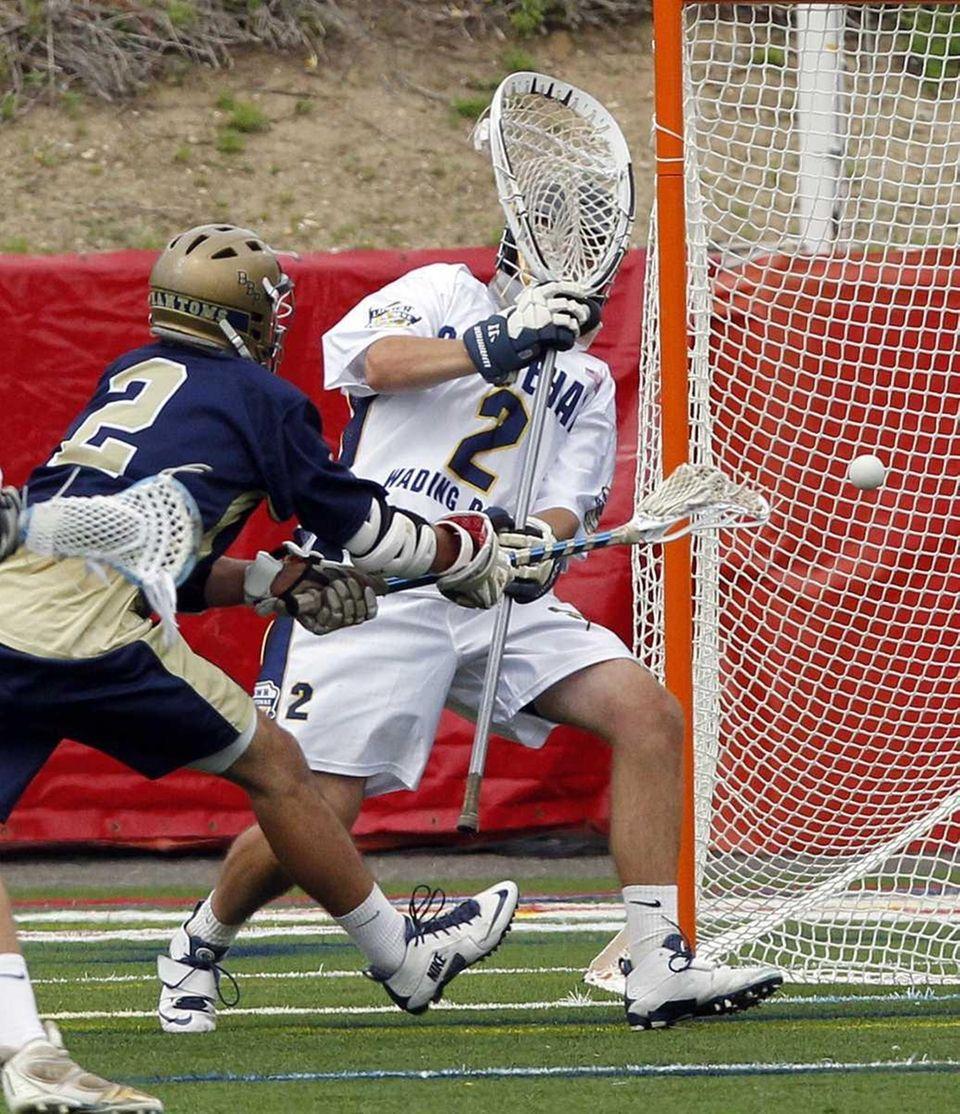 Bayport-Blue Point's Josh Shaw (2) scores from in