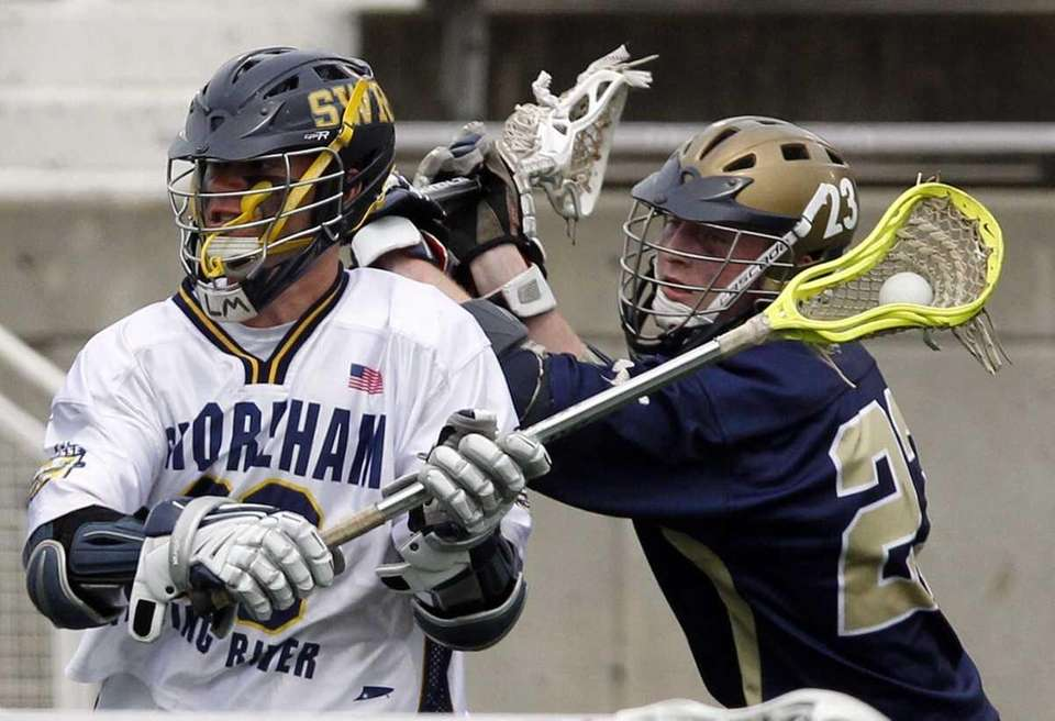 Shoreham-Wading River's Tim Rotanz (20) is marked by