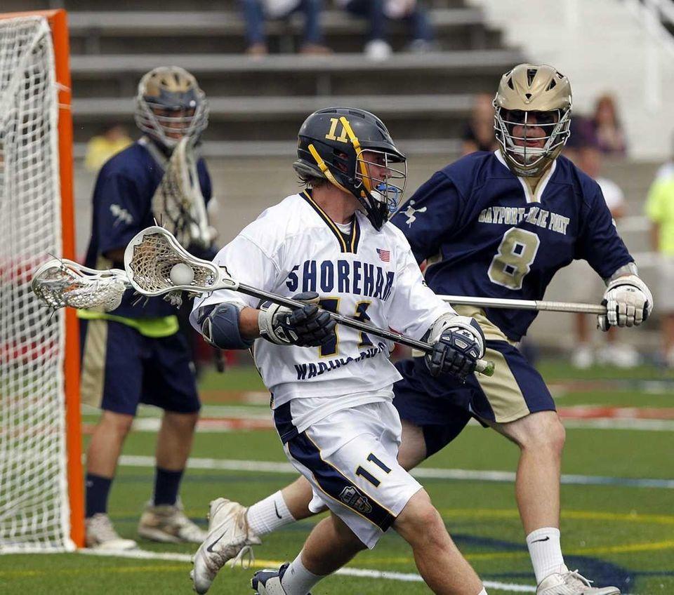 Shoreham's James Higgins (11) moves around the goal