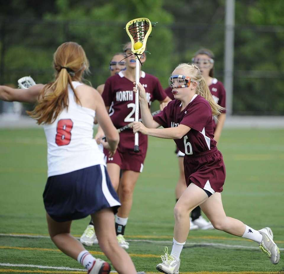North Shore's Meaghan Brennan shoots to score the