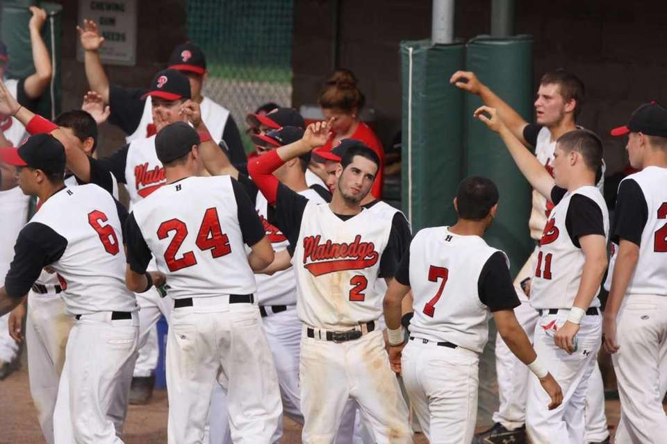 Plainedge celebrates scoring two runs in the second