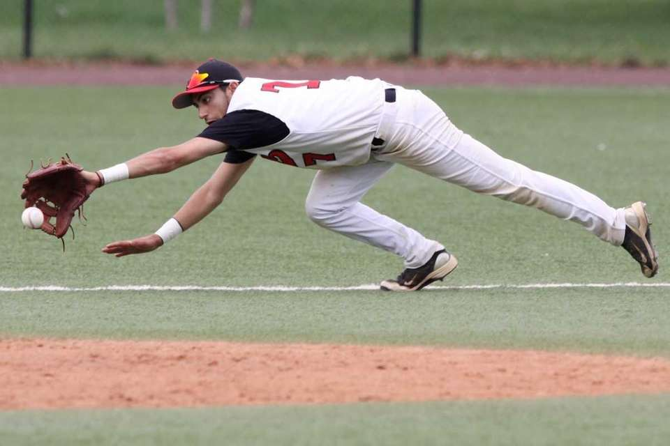 Plainedge's Joe Hauser dives for a ball. (May