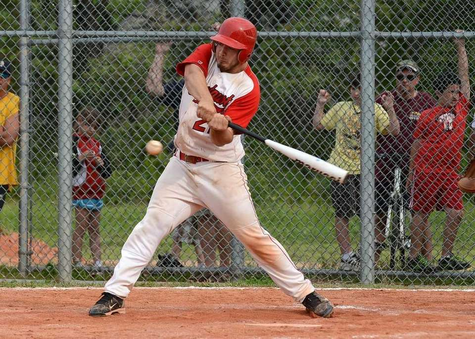 Connetquot's John Fiederlein (21) connects on a three-run