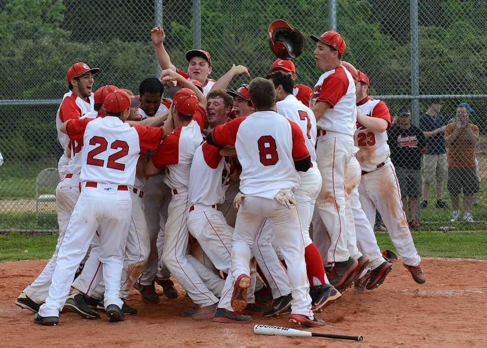 Connetquot players swarm John Fiederlein at the plate