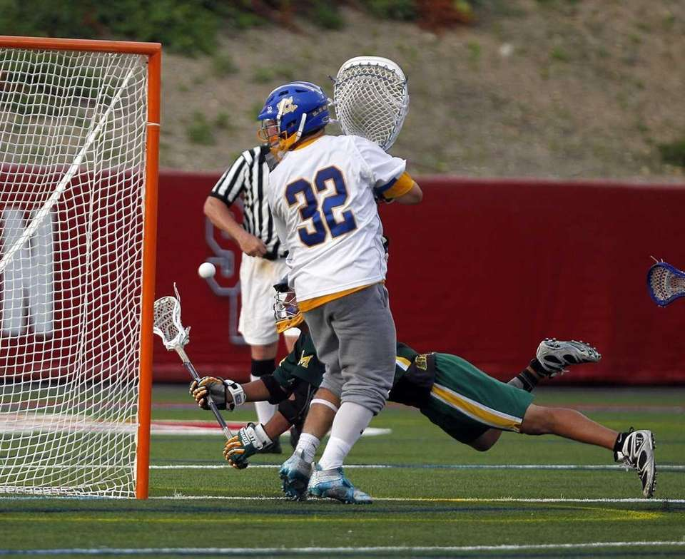 West Islip goalie Jack Kelly (32) deflects a