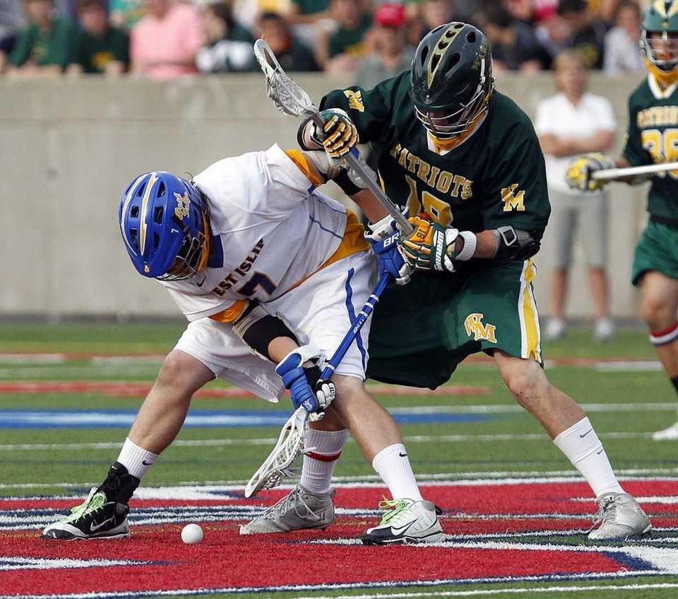 West Islip's Jon Reese (7) controls the faceoff