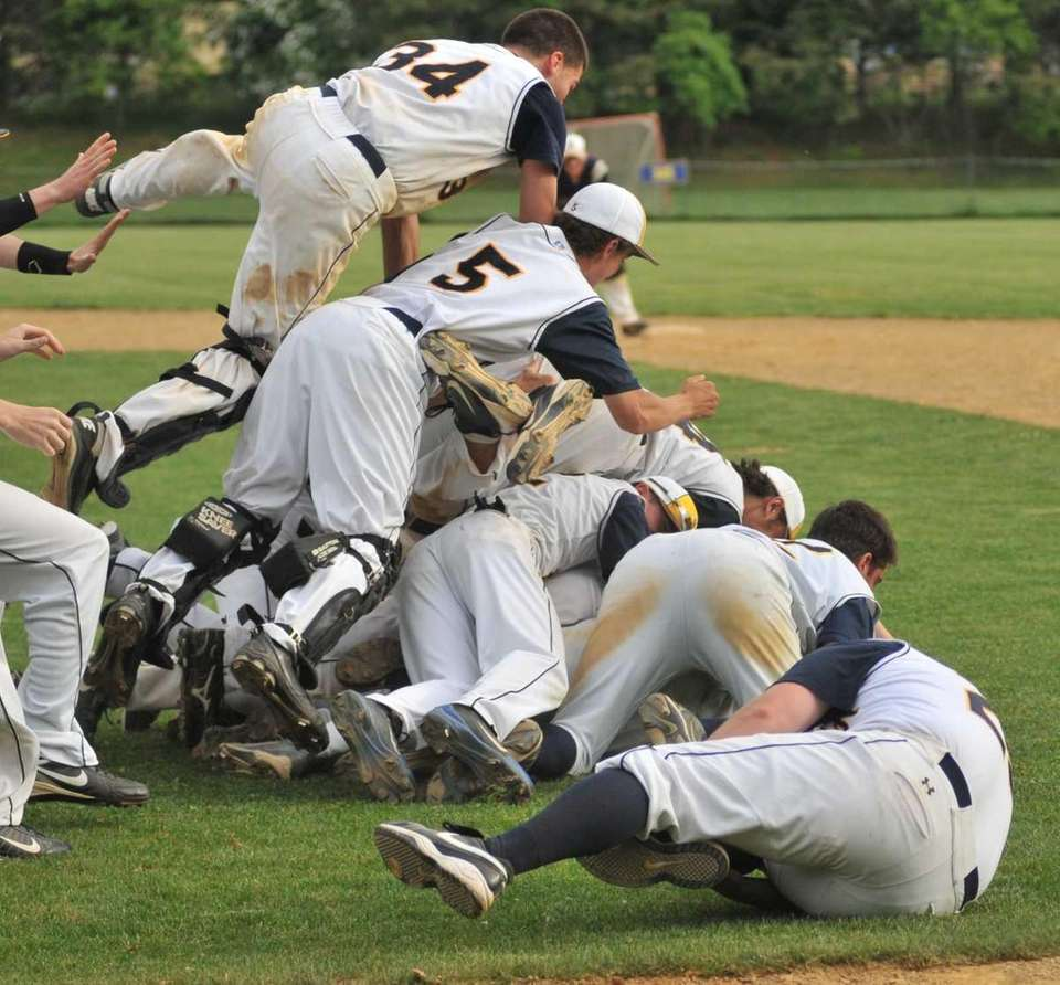 Shoreham-Wading River outfielder Drew Sperruzzi (31) gets piled