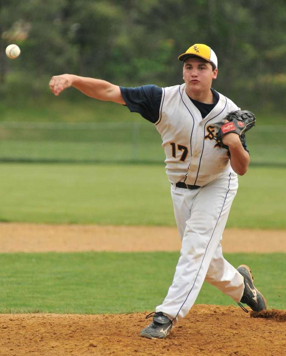 Shoreham-Wading River starting pitcher Dan DeVito (17) delivers